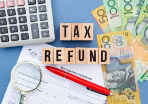 tax refund in blocks and money on the side
